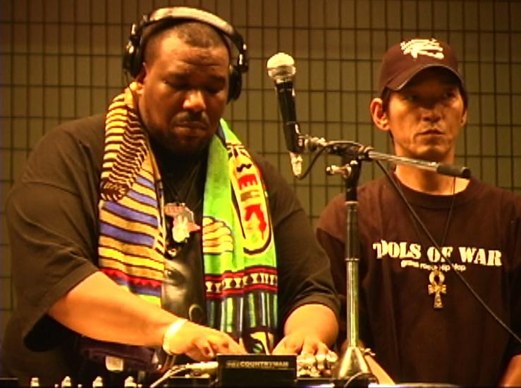 Afrika Bambaataa and DJ Yutaka, via Wikipedia