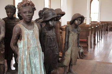 Bronze statues of enslaved children at Whitney Plantation, Louisiana.