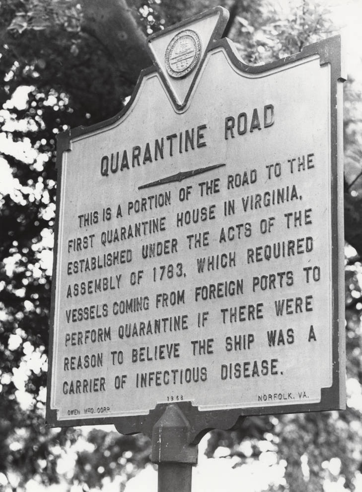 Photo of a roadside historical marker in Norfolk, VA, that reads: Quarantine Road. This is a portion of the road to the first quarantine house in Virginia, established under the acts of the assembly of 1783, which required vessels coming from foreign ports to perform quarantine if there were reason to believe the ship was a carrier of infectious disease.